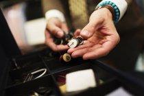 Fashion designer choosing buttons — Stock Photo