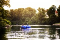 Friends pedal boating on channel — Stock Photo