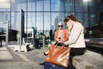 Businesswomen using technologies — Stock Photo