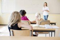 Female teacher teaching class — Stock Photo