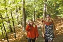 Young women walking in forest — Stock Photo