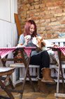 Young woman kissing Basset Hound — Stock Photo