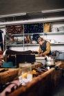 Male worker in bag factory - foto de stock