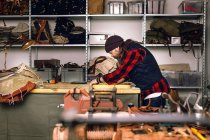 Man in bag factory — Stock Photo