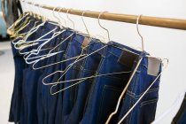 Jeans hanging from rack — Stock Photo