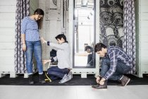 Fashion designer taking measurement — Stock Photo