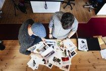Businessmen analyzing photographs — Stock Photo