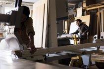 Carpenters working in workshop — Stock Photo