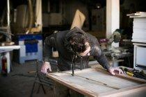 Carpenter holding folding ruler — Stock Photo