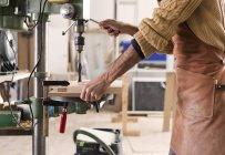 Carpenter drilling wood — Stock Photo