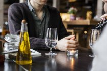 Man sitting at table in restaurant — Stock Photo