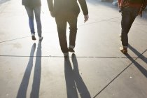 Men walking on street — Stock Photo