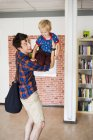 Playful father lifting son — Stock Photo