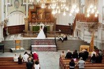 Wedding ceremony in church — Stock Photo