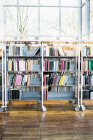 Books arranged in shelves at library — Stock Photo