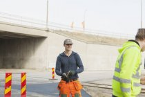 Manual workers at road — Stock Photo
