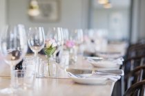 Wine glasses arranged on tables — Stock Photo