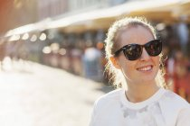 Happy young woman in sunglasses — Stock Photo