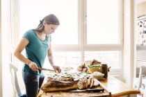Woman preparing open faced sandwiches — Stock Photo