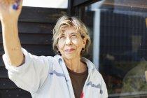 Smiling senior female artist — Stock Photo
