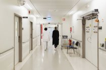 Women walking at hospital corridor — Stock Photo