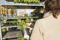 Mature female friends purchasing plants — Stock Photo