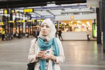 Woman at railroad station — Stock Photo