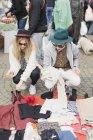 Man and woman at flea market — Stock Photo