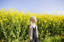 Girl at rapeseed field — Stock Photo