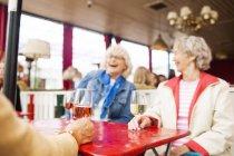 Senior women drinking wine — Stock Photo
