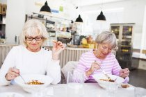 Senior women eating food — Stock Photo