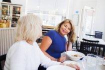 Senior women eating food — Stock Photo