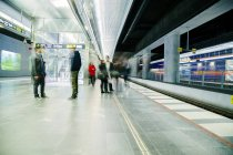 Commuters at underground railway station — Stock Photo