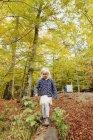 Girl walking on log in park — Stock Photo