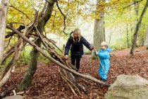 Mother and son making wooden tent — Stock Photo