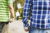 Men holding balls while playing boule — Stock Photo
