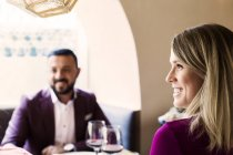 Couple sitting at restaurant — Stock Photo