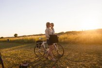 Young couple walking at garden — Stock Photo