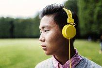 Young man wearing headphones — Stock Photo