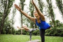 Young women practicing yoga — Stock Photo