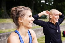 Happy fit women at park — Stock Photo