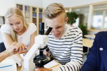 University student using microscope — Stock Photo