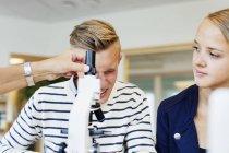 University student using microscope — Stock Photo