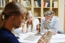 University students studying in library — Stock Photo