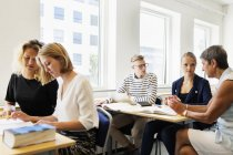 Young students studying in classroom — Stock Photo