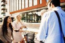 Friends with bicycles standing outside — Stock Photo