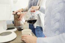 Female friends preparing coffee — Stock Photo