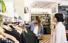 Women shopping at boutique. — Stock Photo