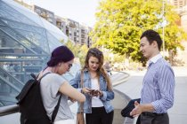 Woman with friends outside railway station — Stock Photo