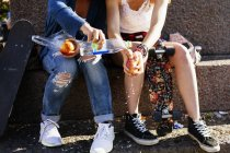 Girls washing apple on street — Stock Photo
